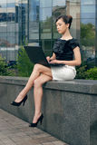 Young woman with laptop. Young businesswoman sitting with laptop royalty free stock images