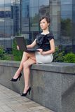 Young woman with laptop. Young woman sitting with laptop stock photography