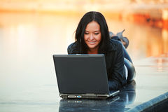 Young woman with laptop. On the river embankment Royalty Free Stock Images