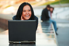 Young woman with laptop. Stock Photos