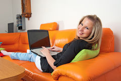 Young woman with laptop Stock Photography