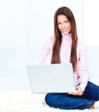 Young woman with laptop. Pretty young woman with laptop on carpet at home stock images