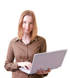 Young woman with laptop. Young woman standing while holding laptop in her hands, isolated on white Stock Image