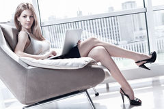 Young woman with laptop Royalty Free Stock Image