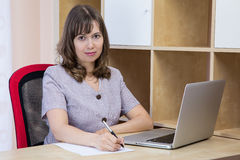 Young Woman with a Laptop Stock Image