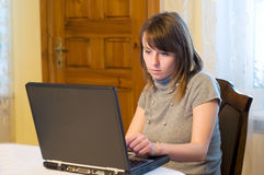 Young woman with laptop. Browsing internet sites Stock Photos