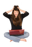 Young woman and laptop Stock Images