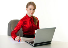 Young woman with laptop. Working at office stock photos