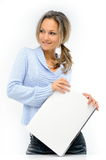 Young woman with laptop against white Royalty Free Stock Photos