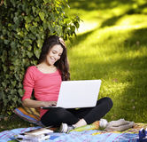 Young woman with the laptop Stock Image