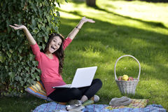 Young woman with the laptop Stock Photography