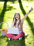 Young woman with the laptop Stock Images