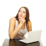 The young woman with the laptop behind a table Royalty Free Stock Photography