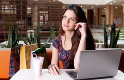 Young woman with a laptop at cafe Stock Photo