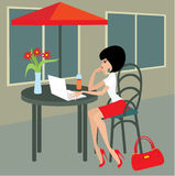 Young woman with the laptop in cafe Royalty Free Stock Images