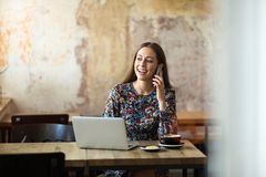 Young woman with laptop in cafe royalty free stock images