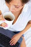 Young woman with laptop and coffee Royalty Free Stock Photos