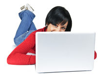 Young woman with laptop computer Stock Image