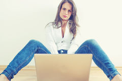 Young woman with laptop computer Stock Images