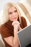 Young woman with laptop computer Stock Photos