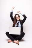 Young woman with laptop computer celebrating success, Stock Photo