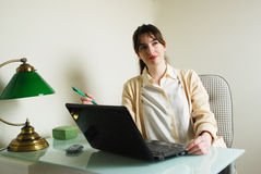 Young Woman with Laptop Computer Contemplating Royalty Free Stock Image