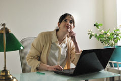 Young Woman with Laptop Computer Daydreaming Royalty Free Stock Image