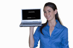 Young woman with laptop computer in hand, smiling, cut out Royalty Free Stock Image