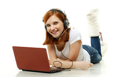 Young woman with a laptop and headset. Stock Image