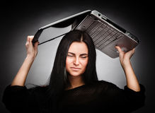 Young woman with a laptop on her head Stock Photos