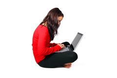Young woman with laptop on her lap. Isolated on white background Stock Photo
