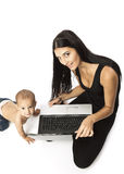 Young woman with a laptop and her little son Royalty Free Stock Photo