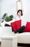 Young woman on laptop at home Stock Photography