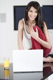 Young woman on laptop at home Stock Photos
