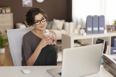 Young woman with laptop at home Royalty Free Stock Images