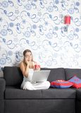 Young woman with laptop at home Stock Photos
