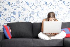 Young woman with laptop at home Royalty Free Stock Photo