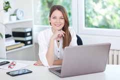 Young woman at laptop Royalty Free Stock Photography