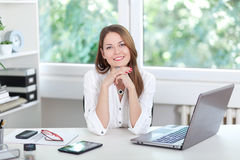 Young woman at laptop Stock Photo