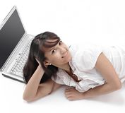 Young woman with laptop lying on the floor .isolated on white. Photo with copy space Royalty Free Stock Image