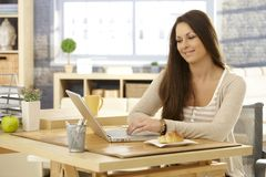 Young woman with laptop in the morning Royalty Free Stock Photo