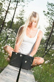 Young woman with laptop. In nature Royalty Free Stock Photos