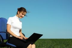 Young woman with laptop outdoor Stock Images
