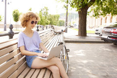 Young woman with laptop outdoor Royalty Free Stock Photography