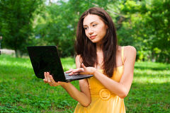 Young woman with laptop outdoor Royalty Free Stock Images