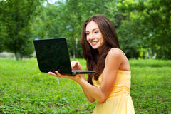 Young woman with laptop outdoor Stock Photo
