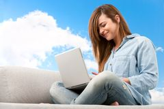 Young woman with laptop outdoors. Stock Photos
