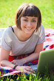 Young woman with a laptop Stock Photography