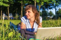 Young woman with laptop outdoors Royalty Free Stock Photography