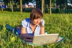 Young woman with laptop outdoors Royalty Free Stock Photo